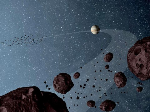 New results from NASA's Wide-field Infrared Explorer, or WISE, reveal that the Jovian Trojans -- asteroids that lap the sun in the same orbit as Jupiter -- are uniformly dark with a hint of burgundy color, and have matte surfaces that reflect little sunlight. (Image credit: NASA/JPL-Caltech)