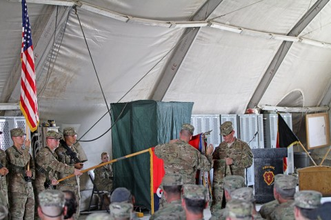 """Col. R.J. Lillibridge, commander of the 3rd Brigade Combat Team """"Rakkasans"""", 101st Airborne Division (Air Assault), Task Force 3-101, and Command Sgt. Maj. Eric Crabtree, Command Sgt. Maj. of the 3rd BCT, 101st ABN DIV (ASSLT), inspect their Brigade colors after they uncased them at the Transfer of Authority ceremony at Forward Operating Base Salerno, Khowst Province, Afghanistan, Oct. 6, 2012. (Photo by Army Sgt. 1st Class Abram Pinnington)"""