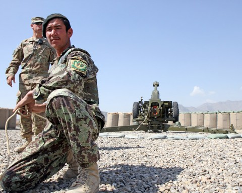 "A soldier with the Afghanistan National Army's 4th Kandak, 1st Infantry Brigade, 203rd Afghan Army Corps, prepares to pull the firing cord on a Russian made D-30 122mm howitzer during a dry-run firing exercise as U.S. Army Master Sgt. Liviu Ivan, who hails from Gaithersburg, Md., and a D-30 howitzer subject matter expert with 3rd Battalion, 320th Field Artillery Regiment, 3rd Brigade Combat Team ""Rakkasans,"" 101st Airborne Division (Air Assault), watches over to ensure the gun-line runs smoothly at Camp Clark, Oct. 13, 2012. (Photo by Sgt. 1st Class Abram Pinnington)"