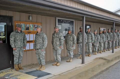 Soldiers attending the Warrior Leader Course at the Staff Sgt. John W. Kreckel NCO Academy at Fort Campbell, KY, display their military bearing and discipline as they wait in line for lunch Oct. 7th. Numerous soldiers of the 159th CAB have graduated on the Commandant's List in the last four consecutive classes. (U.S. Army photo by Spc. Jennifer Andersson)