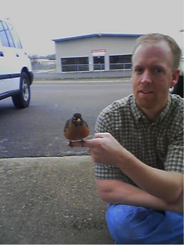 Mat with one of the Robins perched on his finger.