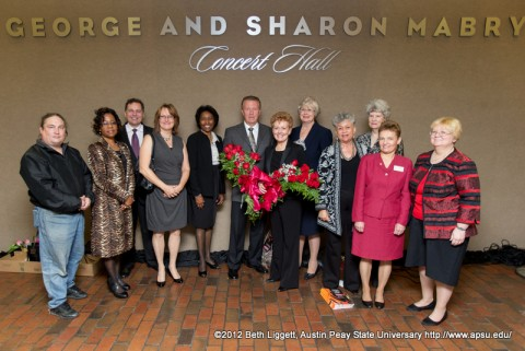 The Board of the Clarksville Community Concert Association pose for a photograph with George and Sharon Mabry