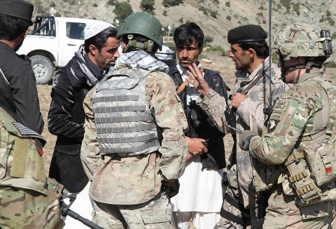U.S. Army 2nd Lt. Elijah Bales, a Knoxville, TN, native and platoon leader with Company C, 1st Battalion, 187th Infantry Regiment, 3rd Brigade Combat Team, 101st Airborne Division (Air Assault), speaks through an interpreter to a group Afghan Uniformed Police while conducting a presence patrol led by AUP and Afghan Border Police in a village near Chamkani, Oct. 23, 2012. (U.S. Army photo by Sgt. 1st Class Abram Pinnington, TF 3-101 Public Affairs)