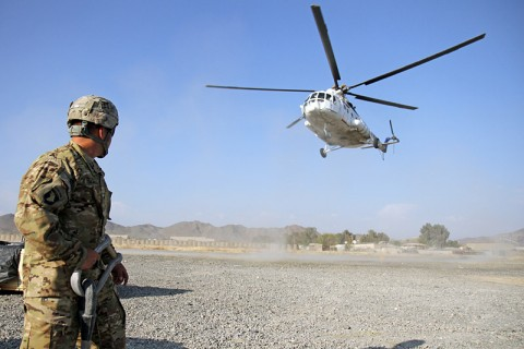 "U.S. Army Spc. Pete Sigala, who hails from Anaheim, Calif., a helicoper landing zone sling load specialist from Headquarters Company, 626th Brigade Support Battalion, 3rd Brigade Combat Team ""Rakkasans,"" 101st Airborne Division (Air Assault), awaits as a civilian contacted air asset helicopter approaches for a sling load of supplies at Forward Operating Base Salerno, Nov. 5, 2012. (U.S. Army photo by Sgt. 1st Class Abram Pinnington, TF 3/101 Public Affairs)"