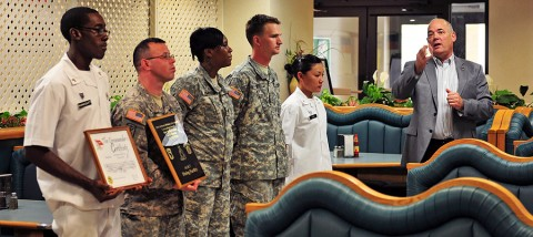 "Retired Command Sgt. Maj. Carl E. Christian, who retired as the FORSCOM command sergeant major in 2005, emphasizes to soldiers with the 4th Brigade Combat Team, 101st Airborne Division, Oct. 17, 2012, the significance of earning the 101st Airborne Division Commanding General's Best Dining Facility or ""Best Mess"" of the Quarter at Fort Campbell, Ky. This is the second time back-to-back that the Currahee Dining Facility earned this award. (U.S. Army photo by Maj. Kamil Sztalkoper, 4th Brigade Combat Team Public Affairs)"