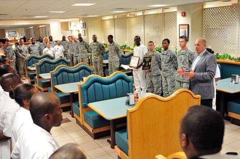 """Retired Command Sgt. Maj. Carl E. Christian, who retired as the FORSCOM command sergeant major in 2005, emphasizes to soldiers with the 4th Brigade Combat Team, 101st Airborne Division, Oct. 17, 2012, the significance of earning the 101st Airborne Division Commanding General's Best Dining Facility or """"Best Mess"""" of the Quarter at Fort Campbell, Ky. This is the second time back-to-back that the Currahee Dining Facility earned this award. (U.S. Army photo by Maj. Kamil Sztalkoper, 4th Brigade Combat Team Public Affairs)"""