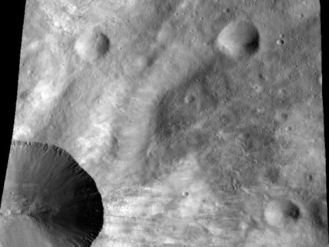 This image from NASA's Dawn spacecraft shows a close up of part of the rim around the crater Canuleia on the giant asteroid Vesta. Canuleia, about 6 miles (10 kilometers) in diameter, is the large crater at the bottom-left of this image. (Image credit: NASA/JPL-Caltech/UCLA/MPS/DLR/PSI/Brown)