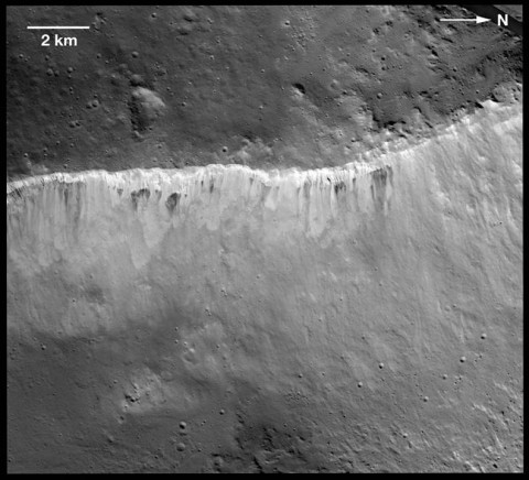 The interplay of bright and dark material at the rim of Marcia crater on Vesta is visible in this image mosaic taken by NASA's Dawn spacecraft. The brightness variation at Vesta is now known to be among the most extreme of the rocky bodies in the solar system. Scientists believe the bright material is uncontaminated by dark material and is native to Vesta. (Image Credit: NASA/JPL-Caltech/UCLA/MPS/DLR/IDA/LPI/ASU)