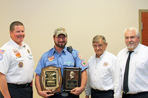 (L to R) Wade Kunstmann, Assistant Chief for the Cunningham Volunteer Fire Department; Shaun Arms, Overall 2012 Firefighter of the Year; Jerry Buchanan, Montgomery County Fire Chief; and Ed Baggett, Assistant Montgomery County Fire Chief.