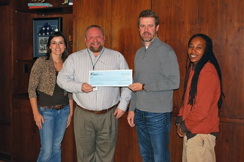"YMCA check was accepted by James ""O'Bee"" O'Bryant Executive Director of the Clarksville Area YMCA. From L to R: Jessica Goldberg (Race Director), O'Bee O'Bryant (YMCA Executive Director), Jim Manning (CDE Lightband), and Channel Lemon (Race Director)."