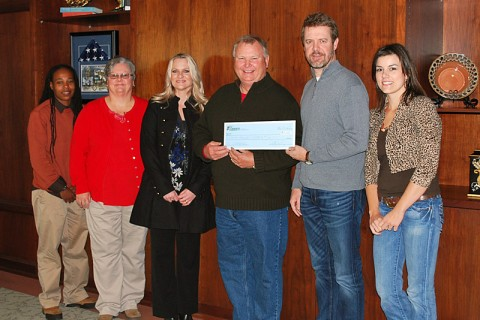Fort Campbell Historical Foundation check was accepted by Robert Nichols. From L to R: Channel (Race Director), Susan, Nita, Robert (FCHF), Jim Manning (CDE Lightband) and Jessica Goldberg (Race Director).