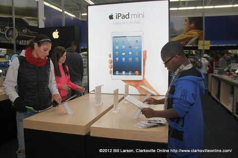 Best Buy customers checking out the iPads