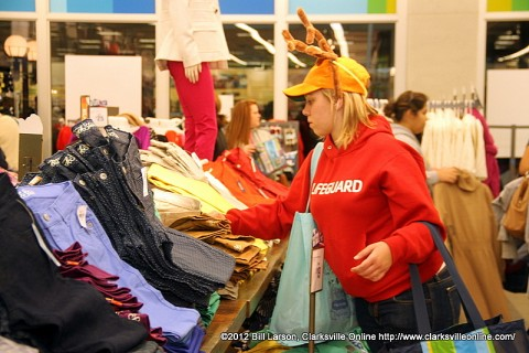 A shopper wearing Antlers on Black Friday