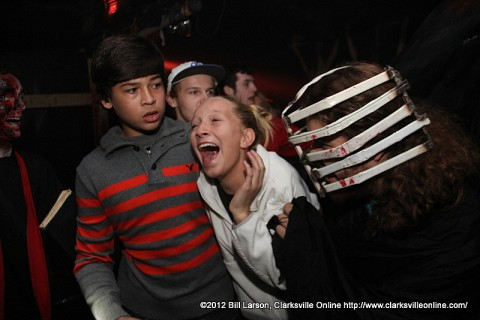 A terrified young lady at the 2012 Bikers Who Scare Haunted House