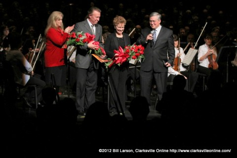 The audience applauds the Mabry's on Stage with APSU President Tim Hall and his wife Lee