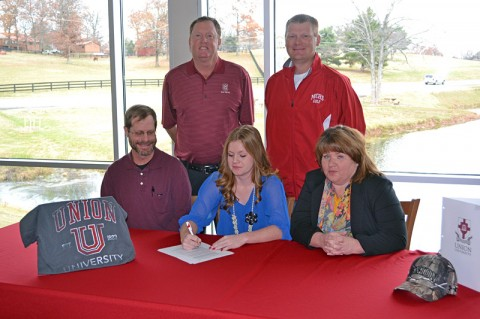 KayCee and her parents, Coach Greg Lyle in the red jacket and Jeff Vaughn.