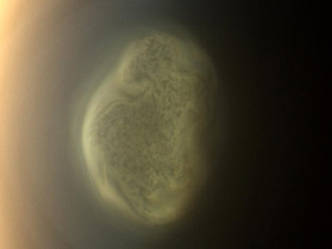 This true color image captured by NASA'S Cassini spacecraft before a distant flyby of Saturn's moon Titan on June 27th, 2012, shows a south polar vortex, or a swirling mass of gas around the pole in the atmosphere. (Image Credit: NASA/JPL-Caltech/Space Science Institute)
