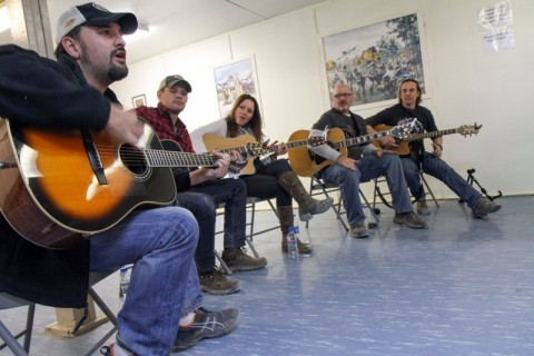 Carlton Ray Scott (near), plays a song as other members of the Nashville to You Tour look on at Forward Operating Base Gardez, Nov. 15, 2012. Other members of the tour include (after Scott, from left to right) Thomas Verges, Hillary Lindsey, Billy Montana and Keni Thomas. The tour featured Nashville's top songwriters and performers as they traveled throughout Afghanistan performing for deployed soldiers. (U.S. Army Photo by Sgt. 1st Class Abram Pinnington, TF 3/101 PAO)