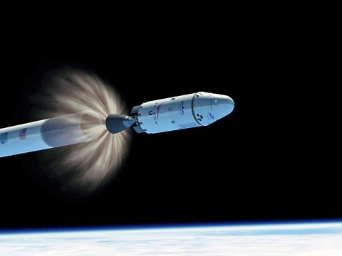 This artist concept shows the second stage engine of a SpaceX Falcon 9 rocket igniting to send the company's Dragon capsule into orbit as the first stage falls away. (Image credit: SpaceX)