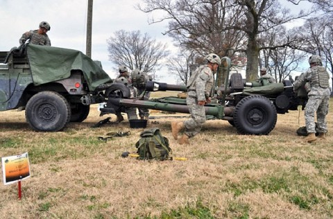 "Soldiers with Bravo Battery, 1st Battalion, 320th Field Artillery Regiment, 2nd Brigade Combat Team, 101st Airborne Division conduct rigging operations on a M-119 Howitzer during a division ""Top Gun"" competition here Nov. 14-15. The competition was held to see who the division's best artillery section is. (Photo by Sgt. Grant Matthes, 101st Airborne Division Public Affairs)"