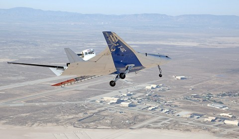 "The upgraded X-48C version of Boeing's Blending Wing Body subscale research aircraft banks over Rogers Dry Lake near ""Contractors' Row"" at Edwards Air Force Base during a test flight Oct. 16, 2012. Combined with the earlier X-48B version, the X-48 technology demonstrator has now flown 100 test missions, more than any other single unmanned X-plane. (NASA / Carla Thomas)"