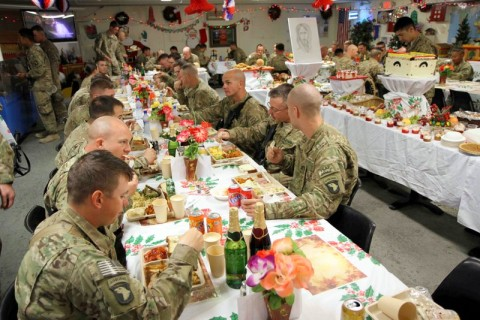 Soldiers assigned to Camp Clark, Afghanistan enjoy a large Christmas lunch on Christmas Day. The dining facility maximized every effort to ensure the Soldiers experienced the best dining expeience possible while deployed away from their familes during the holiday season. (U.S. Army photo by Sgt. 1st Class Abram Pinnington, TF 3/101 Public Affairs)