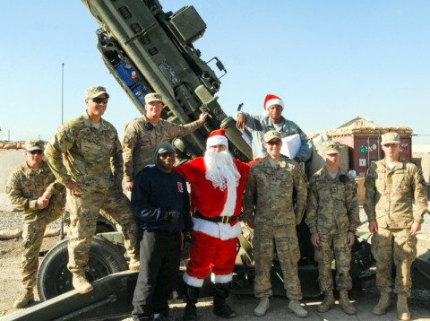 "Chief Warrant Officer 2 Brian Boase, an intelligence cheif, Headquarters, Headquarters Company, 3rd Brigade Combat Team ""Rakkasans,"" 101st Airborne Division (Air Assault), visits Soldiers from Battery A, 3rd Battalion, 320th Field Artillery Regiment,  after delivering care packages dressed Santa at Forward Operating Base Salerno, Afghanistan, Dec. 25th, 2012. Boase dressed as Santa and delivered more than 200 care packages to the Soldiers and civilians of FOB Salerno for Christmas. (U.S. Army photo by Spc. Brian Smith-Dutton, Task Force 3/101 Public Affairs)"