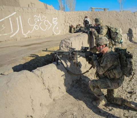 """An infantryman and 240B gunner and another Soldier assigned to Company D, 1st Battalion, 187th Infantry Regiment, 3rd Brigade Combat Team """"Rakkasans,"""" 101st Airborne Division (Air Assault), pull rear security while on a short halt during an Afghan National Security Forces-led mission in rural areas of Zormat District, Afghanistan, December. 10th, 2012.  (U.S. Army photo by Sgt. 1st Class Abram Pinnington, Task Force 3/101 Public Affairs)"""