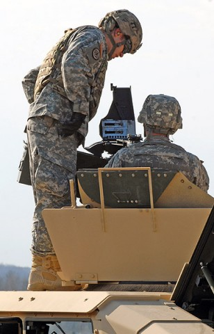 A range safety noncommissioned-officer of the MK 19 grenade machine gun range ensures that a Soldier has properly cleared the weapon system after firing Nov. 26 at Fort Campbell, Ky. The exercise gives Soldiers the opportunity to familiarize themselves with the weapon system for Individual Readiness Training in preparation for a deployment to Afghanistan. (U.S. Army photo taken by Sgt. Alan Graziano, 3rd Brigade Combat Team, 101st Airborne Division)