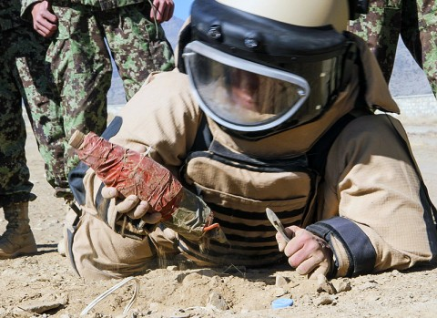 A soldier from the 203rd Corps, AfghanNational Army, successfully defuses an improvised explosive device during an ANA-led counter IED course at Camp Parsa, Afghanistan, Nov. 20, 2012. The six-week counter IED course is designed to equip ANA soldiers with the skills to help defeat Afghanistan's largest threat to its people and security forces. (U.S. Army photo by Sgt. 1st Class Abram Pinnington, TF 3/101 Public Affairs)