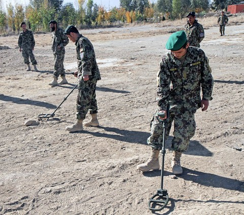 Soldiers from the 203rd Corps, Afghan National Army, conduct counter improvised explosive device measures while utilizing mine detectors during an ANA-led conter IED course at Camp Parsa, Afghanistan, Nov. 20, 2012. The six-week counter IED course is designed to equip ANA soldiers with the skills to help defeat Afghanistan's largest threat to its people and security forces. (U.S. Army photo by Sgt. 1st Class Abram Pinnington, TF 3/101 Public Affairs)