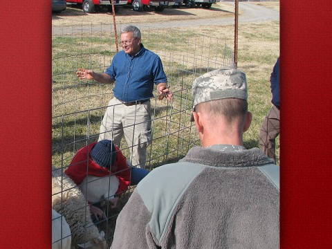 Bob Moore instructs a group of soldiers on how to care for livestock in Afghanistan. (Photo by Dr. Don Sudbrink/APSU).