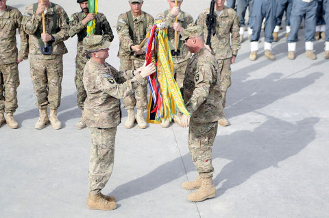 Col. J.P. McGee and Command Sgt. Maj. Thomas W. Eppler, the commander and command sergeant major of the 1st Brigade Combat Team, 101st Airborne Division, uncase the brigade colors December 5th during the Transfer of Authority ceremony from 4th BCT, 4th Infantry Division to the 201st Afghan National Army Corps here. (U.S. Army photo by Sgt. Jon Heinrich, Taskforce 1-101 PAO)