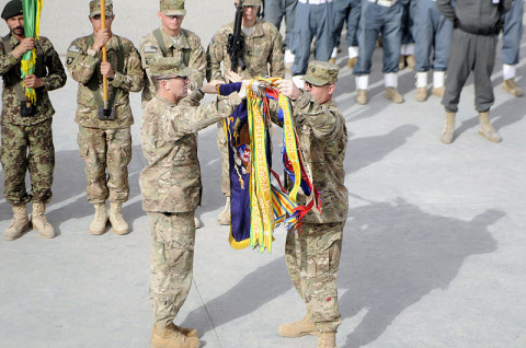 Col. J.P. McGee and Command Sgt. Maj. Thomas W. Eppler, the commander and command sergeant major of the 1st Brigade Combat Team, 101st Airborne Division, uncase the regimental colors December 5th during the transfer of authority ceremony from 4th Brigade Combat Team, 4th Infantry Division, to the 201st Afghan National Army Corps at Forward Operating Base Fenty, Afghanistan. (U.S. Army photo by Sgt. Jon Heinrich, Task Force 1-101 PAO)