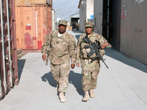 Master Sgt. Lemuel Wynn, Headquarters Support Company, 96th Aviation Support Battalion operations non-commissioned officer in charge, walks with his wife, Sgt. 1st Class Audra Wynn, A Company, 426th Brigade Support Battalion truckmaster, from the helicopter terminal to begin spending Christmas together at Bagram Air Field, Afghanistan, on Christmas Eve. (U.S. Army photo by Sgt. Duncan Brennan, 101st CAB public affairs)