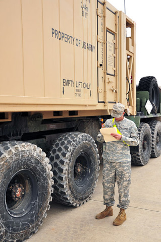 Spc. Spencer B. Olson with Bravo Battery, 4th Battalion, 320th Field Artillery Regiment, 4th Brigade Combat Team, 101st Airborne Division, checks the mechanical inspection data on a Heavy Expanded Mobility Tactical Truck, Palletized Load System during the 4th Brigade's rail-operations inspection station on December 4th, 2012 at Fort Campbell, KY. (U.S. Army photo by Maj. Kamil Sztalkoper, 4th Brigade Combat Team Public Affairs)