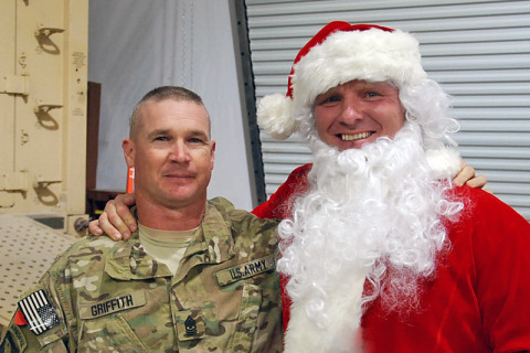 "Command Sgt. Maj. Jeffrey Griffith, Battalion operations senior non-commissioned officer in charge, 3rd Battalion, 187th Infantry Regiment, 3rd Brigade Combat Team ""Rakkasans,"" 101st Airborne Division (Air Assault), poses with Santa Clause during a celebration at Forward Operating Base Salerno, Afghanistan, Dec. 24th, 2012. (Courtesy photo)"