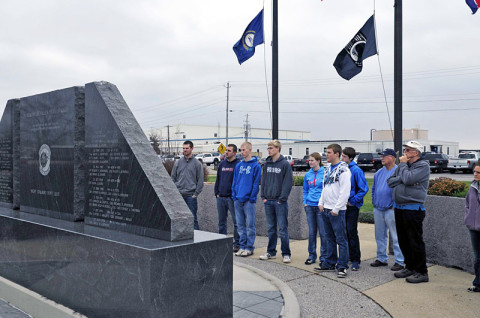 Members of the Friendship Christian Reform Church pay their respects at the Night Stalker monument during a visit to the General Brown compound December 7th at Fort Campbell, KY. The Night Stalker monument serves as a tribute to the 91 fallen Night Stalkers, who paid the ultimate sacrifice for the cause for freedom. (160th SOAR (A)courtesy photo)