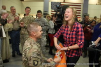 Caitlin Stein places the ring her finger moments after Lieutenant Mathew Miller proposed to her