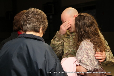 "A ""Strike"" soldier cries even as he smiles moments after being reunited with his family"