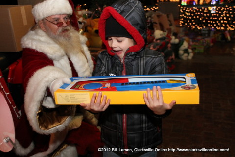 A young boy gets an electric guitar from Santa Claus at Christmas on the Cumberland Last Night.