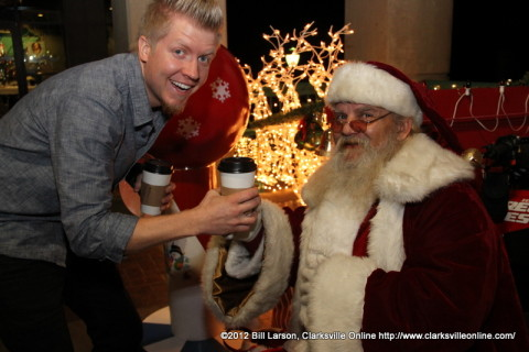 Dave Jenks owner of Apollo Coffee presents a hot chocolate to Santa Klaus