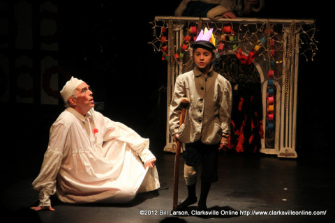 Scrooge learns a Christmas lesson from Tiny Tim in A Christmas Carol at the Roxy Regional Theatre