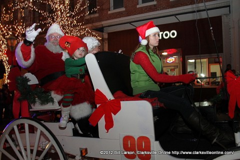 Santa Claus waves to the kids as he passes through Historic Downtown Clarksville