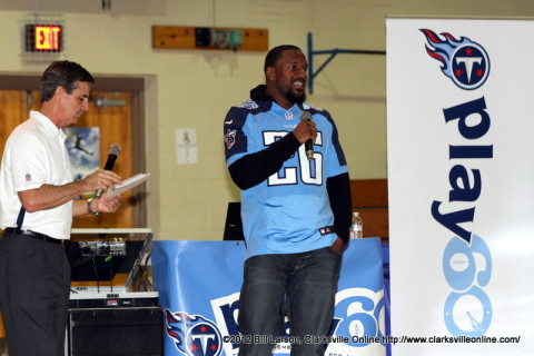 Jerry Blessing the Tennessee Titans Community Relations Coordinator and Safety Jordan Babineaux talking to the kids at Northeast Middle School