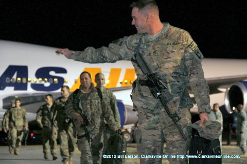 A Strike soldier waves at his family as he heads to the Welcome Home Ceremony Thursday morning