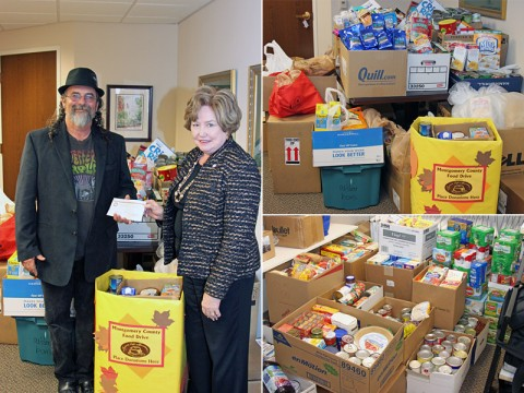 Kenny York accepts a $500.00 check from Montgomery County Mayor Carolyn Bowers as part of the County food drive for Manna Café. Besides the cash donation, the county raised over 2,600 pounds of food.