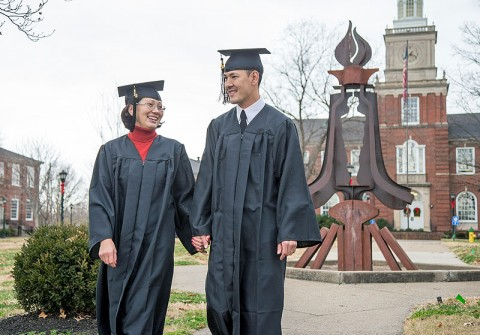 Staff Sgt. Chris Minor and his wife Elvira walk on the lawn in front of the Browning Administration Building at the APSU main campus. The couple graduated December 14th 2012 with their bachelor's degrees from APSU. (Photo by Beth Liggett, APSU photographer)