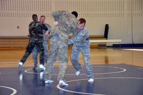 Students in the combatives level one class with the 7th Squadron, 17th Cavalry Regiment, practice moves in order to take down their opponent during a combatives level one course Dec. 12th at Fort Campbell, KY.  (U.S. Army photo by Sgt. Shanika L. Futrell, 159th Combat Aviation Brigade Public Affairs)