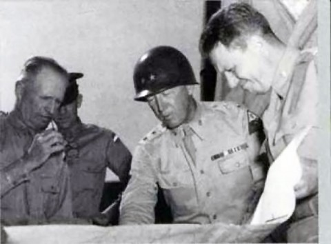 Major General George S. Patton Jr. (center) studies a map during World War II with General Lesley J. McNair (left), chief of staff of General Headquarters and later commanding general of U.S. Army Ground Forces.